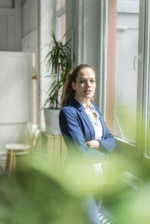 Portrait of confident businesswoman in a loft - JOSF01767