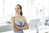 Woman sitting in office after workout - JOSF01797