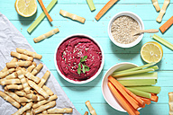 Bowl of beetroot hummus, sesame, carrot and celery crudites and breadsticks - RTBF01001
