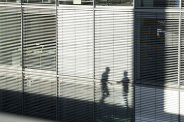 Shadow of two businessmen on a sunblind - FKF02584