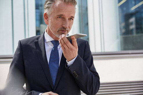 Portrait of businessman using cell phone - SUF00280