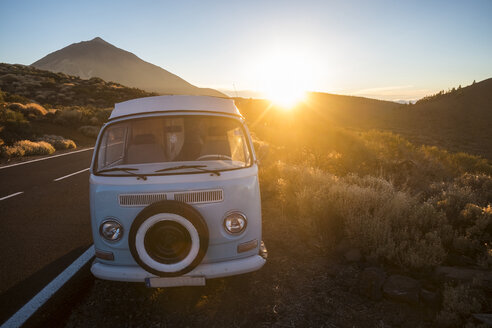 Spain, Tenerife, parked van at roadside by sunset - SIPF01776