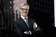Portrait of confident grey-haired businessman outdoors - SBOF00780