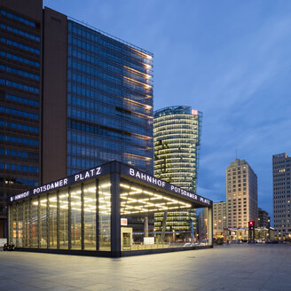 Germany, Berlin, Potsdamer Platz, lighted railway station at twilight - WIF03432