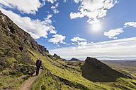 UK, Scotland, Inner Hebrides, Isle of Skye, Trotternish, Quiraing, tourist on hiking trail - FOF09380