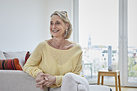 Portrait of smiling mature woman at home on the sofa - RBF06039