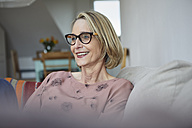 Smiling mature woman at home on the sofa - RBF06066