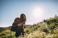 Teenage girl with backpack in nature - VPIF00102