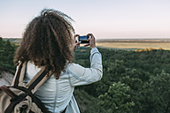 Back view of teenage taking picture of landscape - VPIF00135