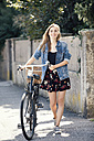 Young woan with bicycle in the city - MAEF12421