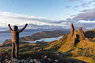 UK, Scotland, Inner Hebrides, Isle of Skye, Trotternish, tourist on peak near The Storr - FOF09390