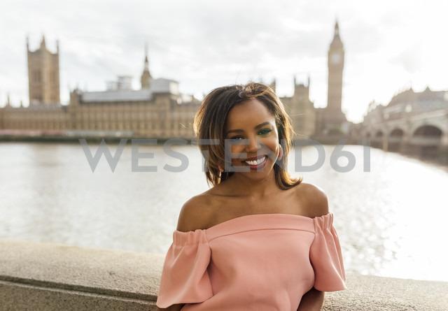 UK, London, portrait of a beautiful woman near Palace of Westminster - MGOF03632