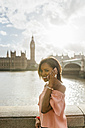 UK, London, woman talking on the phone near Westminster Bridge - MGOF03638