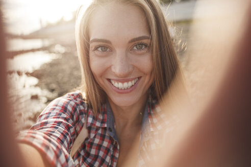 Portait of happy young woman at the riverside - VPIF00168