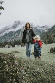 Austria, Vorarlberg, Mellau, mother and toddler on a trip in the mountains - DWF00308