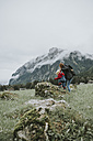 Austria, Vorarlberg, Mellau, mother and toddler on a trip in the mountains - DWF00311