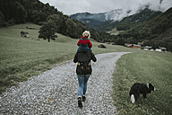 Austria, Vorarlberg, Mellau, mother carrying toddler on shoulders on a trip in the mountains - DWF00314
