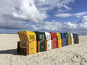 Germany, Juist, Hooded beach chairs at Juist beach - ODF01555