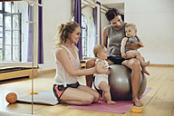 Mothers and babies in exercise room - MFF04022