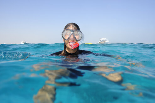 Woman snorkeling in the sea - ECPF00137