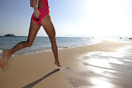 Egypt, Soma Bay, woman running on the beach - ECPF00143