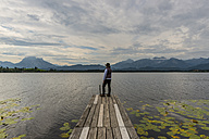 Germany, Bavaria, Allgaeu, Lake Hopfensee, woman standing on jetty - WGF01118