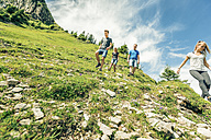 Germany, Bavaria, Pfronten, family hiking on a trail near Aggenstein - PNPF00019