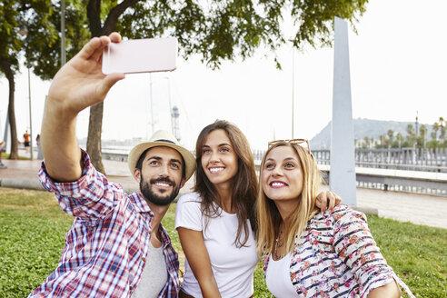 Three friends taking a selfie in park - JRFF01456