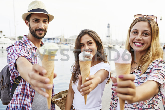 Three smiling friends holding ice cream cones - JRFF01459