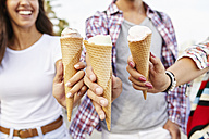 Close-up of three friends holding ice cream cones - JRFF01462