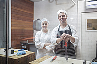 Portrait of smiling man and woman in butchery - ZEF14633