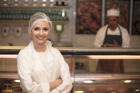 Portrait of smiling woman in butchery - ZEF14636