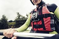 Germany, Bavaria, Allgaeu, close-up of kayaker with action cam - PNPF00064