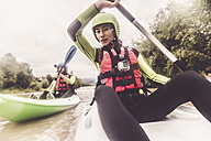 Germany, Bavaria, Allgaeu, couple kayaking on river Iller - PNPF00070
