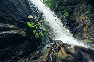 Germany, Bavaria, Allgaeu, young couple canyoning in Ostertal - PNPF00073