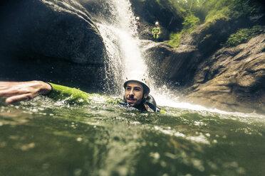 Germany, Bavaria, Allgaeu, man canyoning in Ostertal - PNPF00079