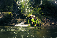 Germany, Bavaria, Allgaeu, young couple canyoning in Ostertal - PNPF00082