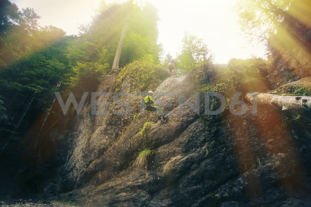 Germany, Bavaria, Allgaeu, young man abseiling in Ostertal - PNPF00085