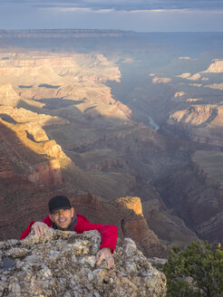 USA, Arizona, Grand Canyon National Park, portrait of climbing tourist - TOVF00099