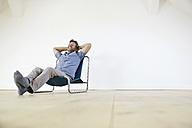 Man sitting in arm chair, daydreaming - PDF01381