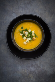 Soup dish of creamed pumpkin soup with croutons and parsley - LVF06283