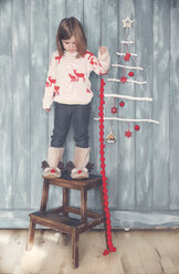 Little girl with Christmas decoration - RTBF01025