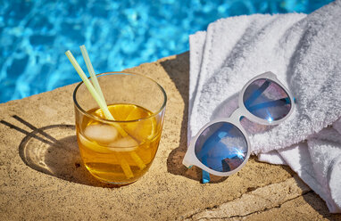 Glass of Crodino, sunglasses and towel at the poolside - DIKF00283