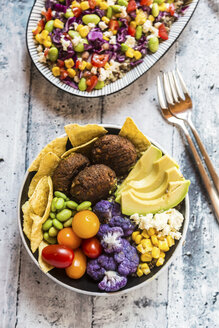 Quinoa veggie bowl of avocado, Edamame, tomatoes, corn, feta, nachos, cauliflower and quinoa fritters - SARF03376