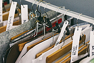 Clothes rail in tailor shop - JUBF00274
