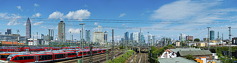 Germany, Frankfurt, view to holding tracks of central station with skyline in the background - AMF05473