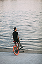 Young man with fixie bike at the waterfront - VPIF00196