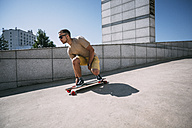 Young man riding skateboard in the city - VPIF00211