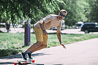 Young man riding skateboard on the street - VPIF00229