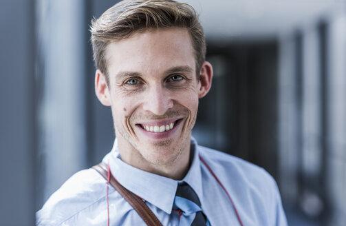 Portrait of smiling businessman - UUF11889